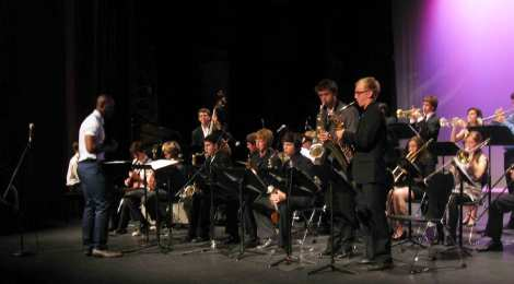 Create a new piece for jazz ensemble